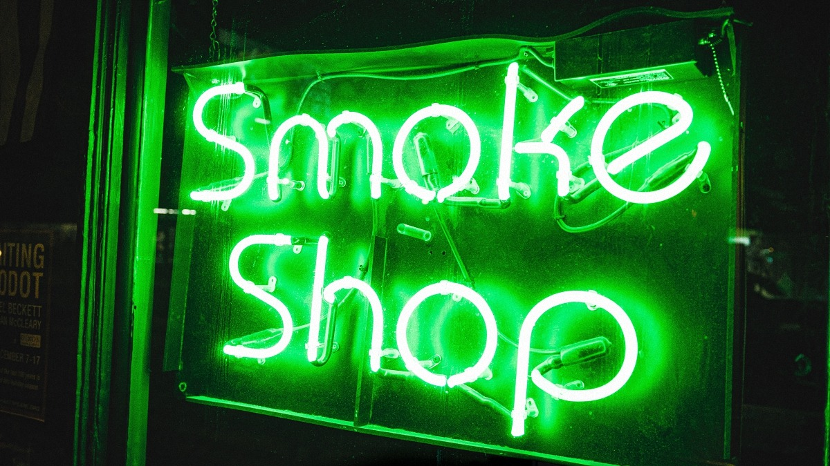 light up sign of a dispensary in chicago reads smoke shop in green