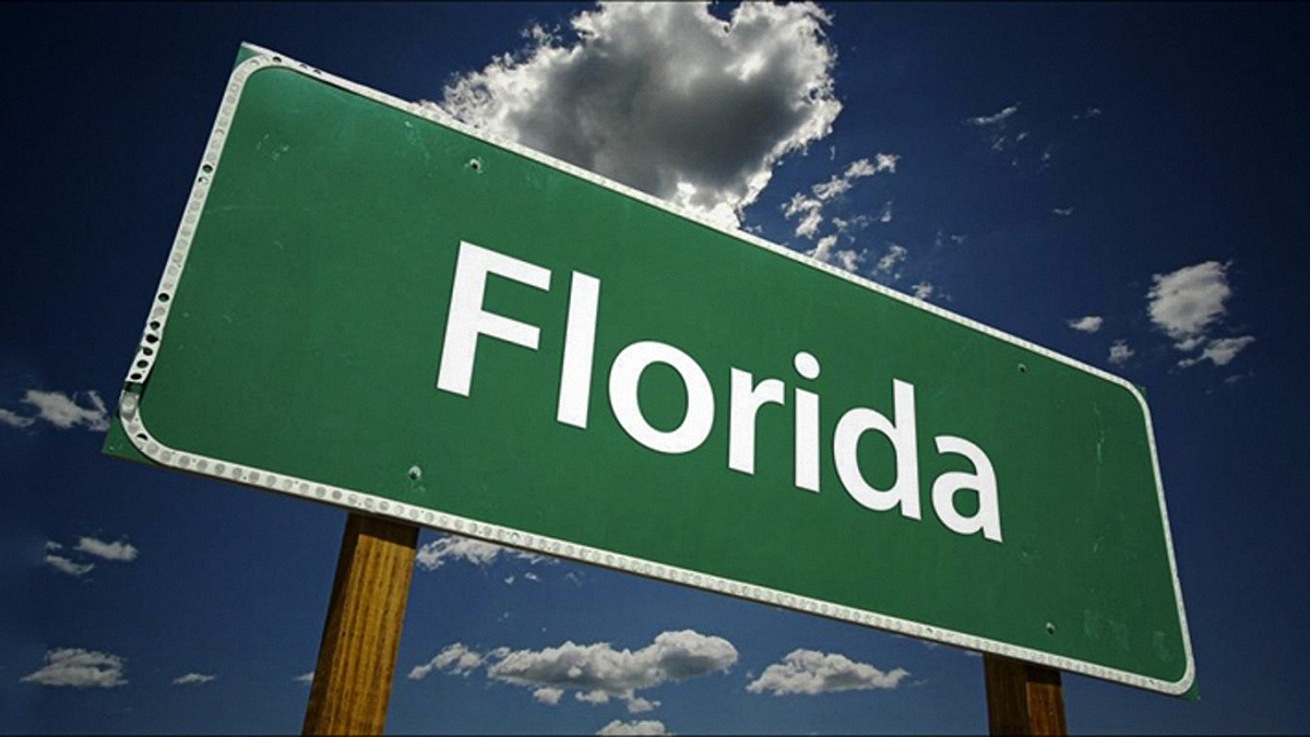 Florida road sign in green and white text