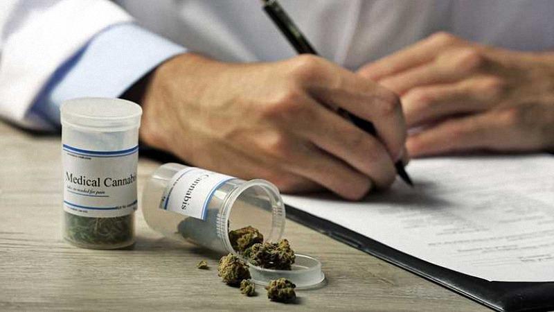 a doctor writing a prescribed medical cannabis