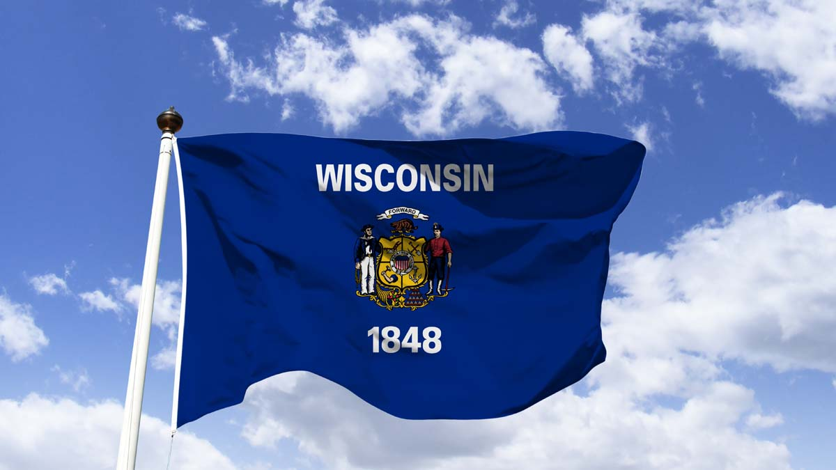 wisconsin flag in blue sky background