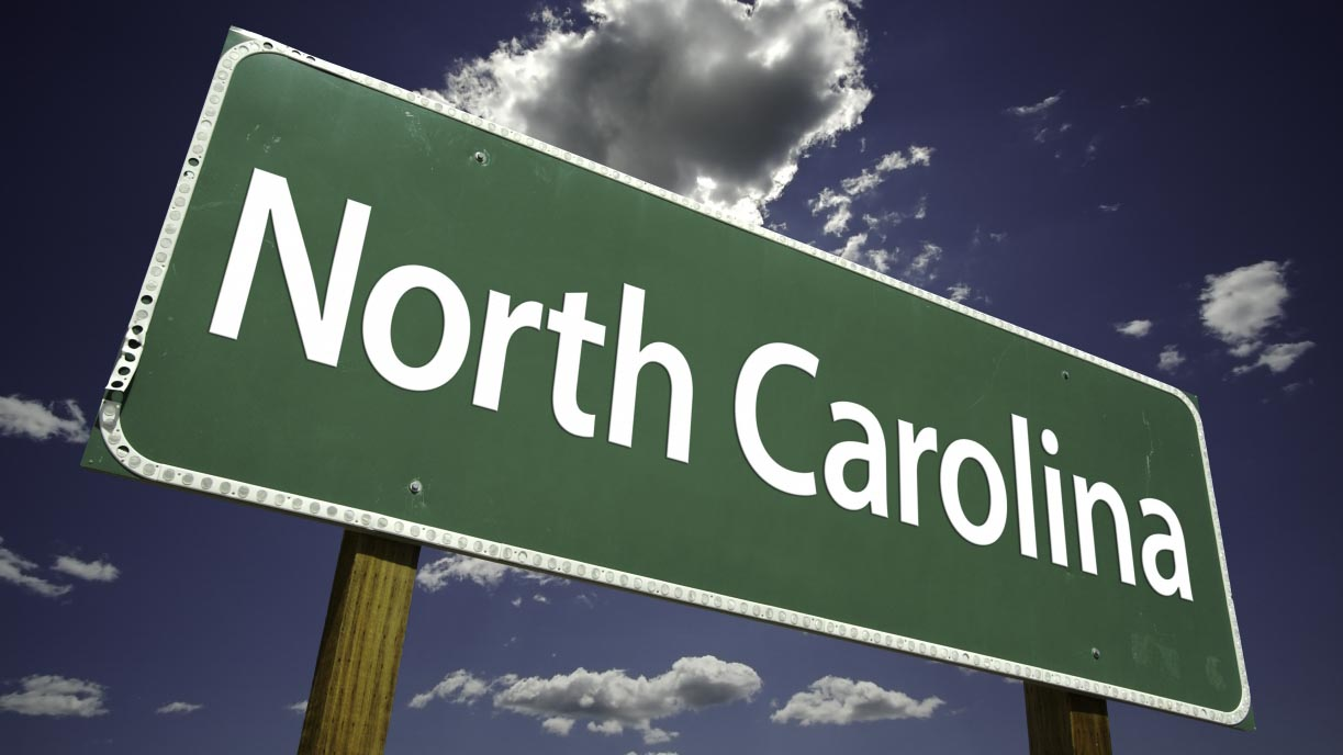 north carolina road sign in green background and white text