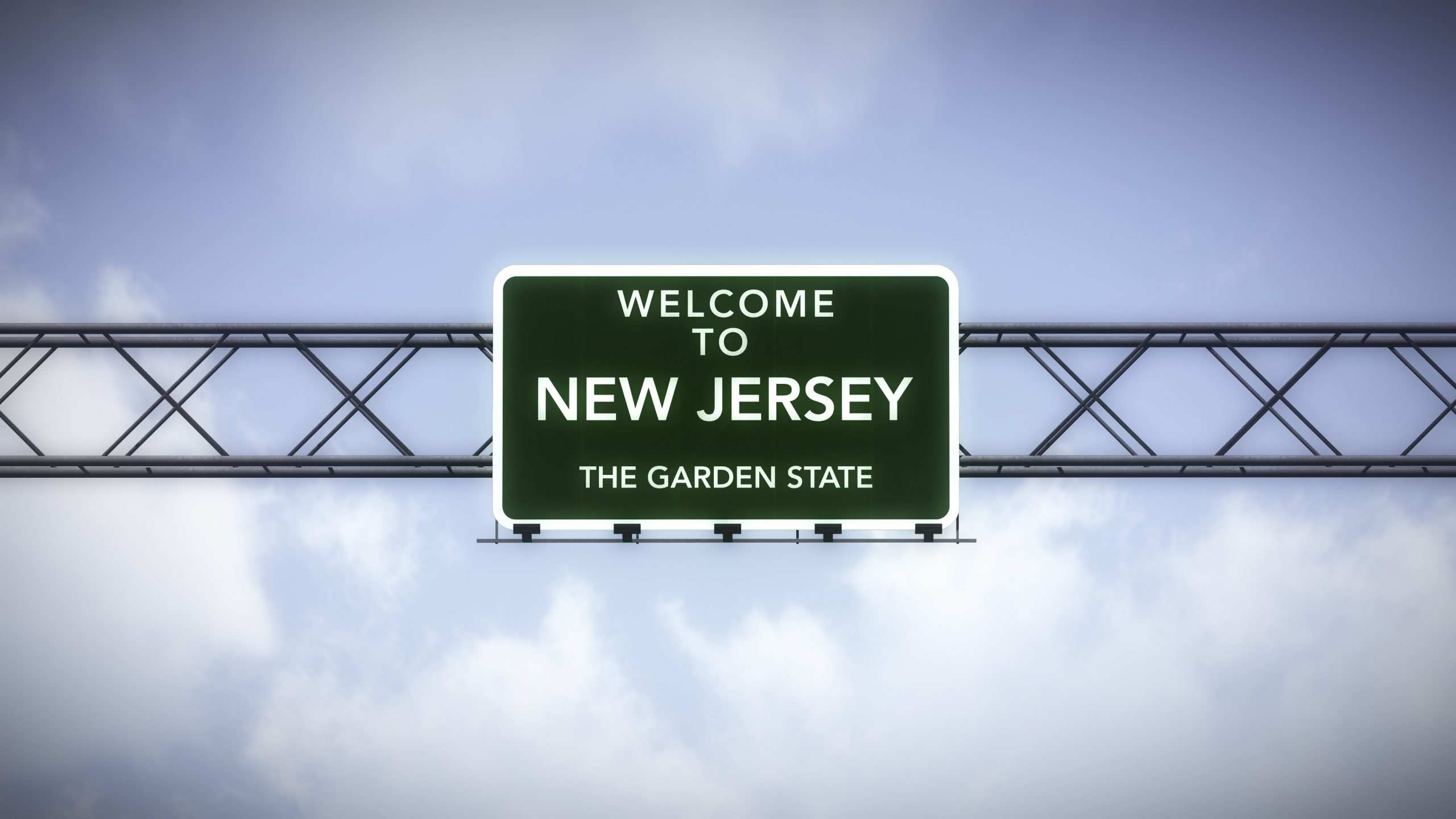 Welcome to New Jersey road sign with blue sky background