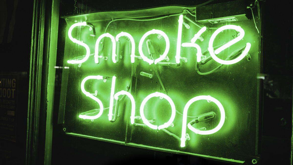 Vt medical cannabis dispensary shop sign in green neon light
