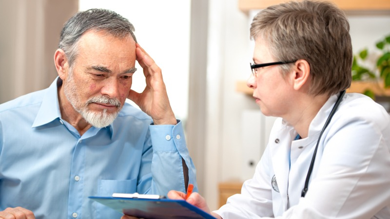 Doctor giving his patient prescription sedatives