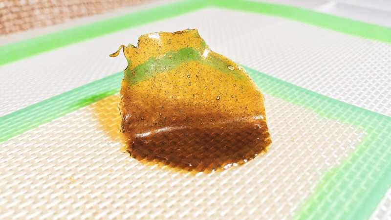 Live CBD Rosin on a backing sheet