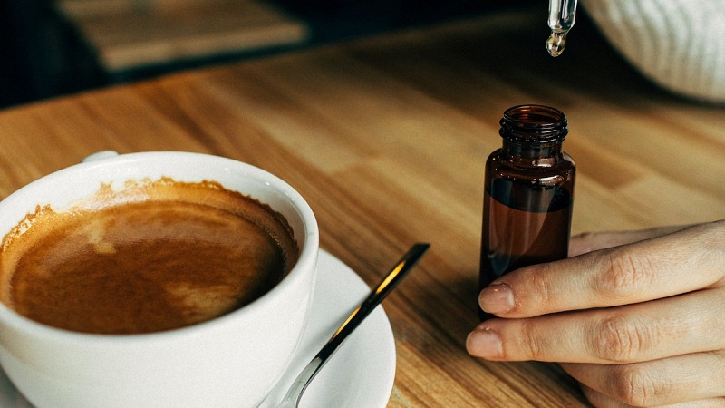 CBD Oil and Coffee in a Cup