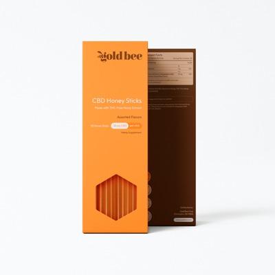 GoldBee CBD Honey Sticks on white background