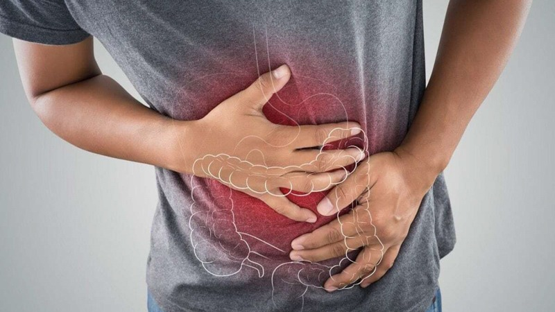 Person Holding His Stomach Aching Due to Constipation