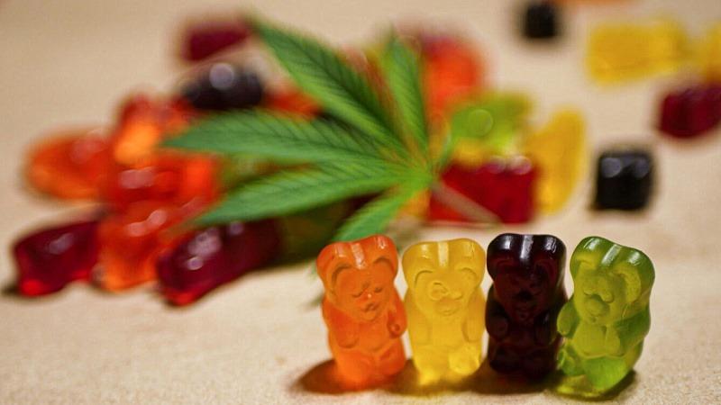 Colorful CBD Gummies with cannabis leaf