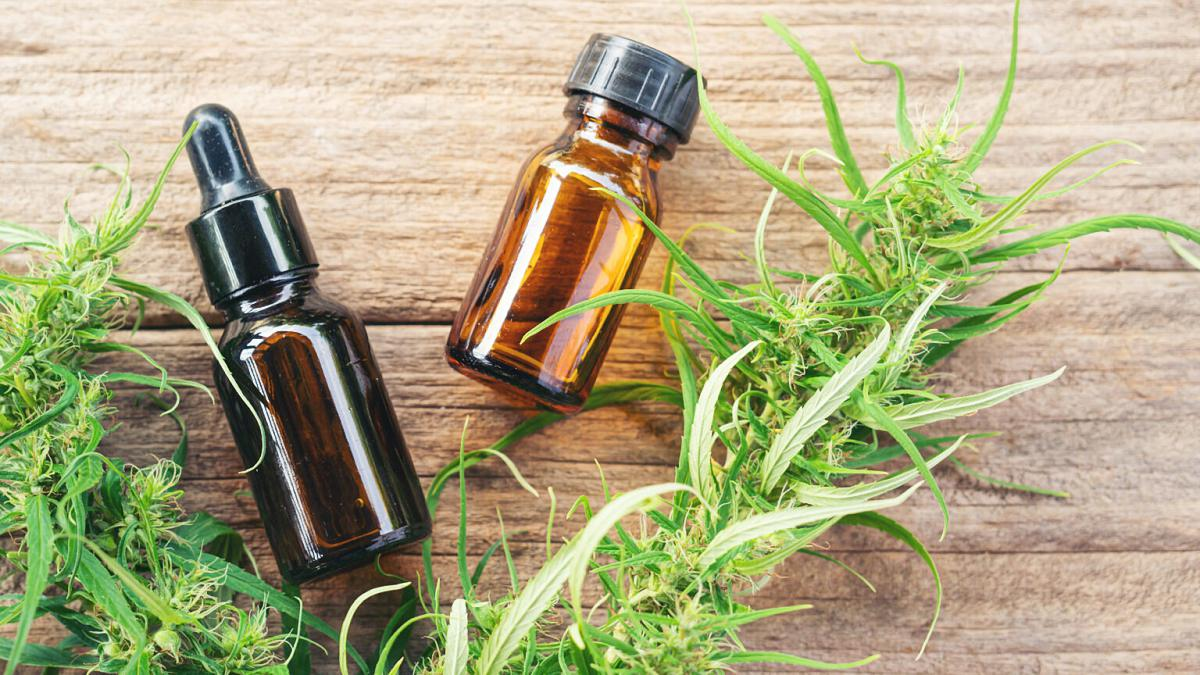 cannabis with cbd and thc extract in a bottle